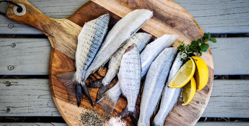 oily fish on a chopping board